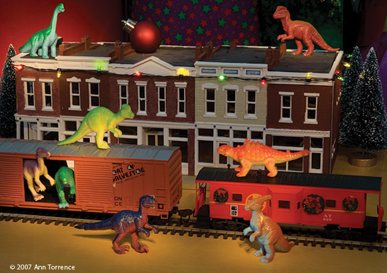 Christmas greeting card dinosaur home for the holidays toy train village scene
