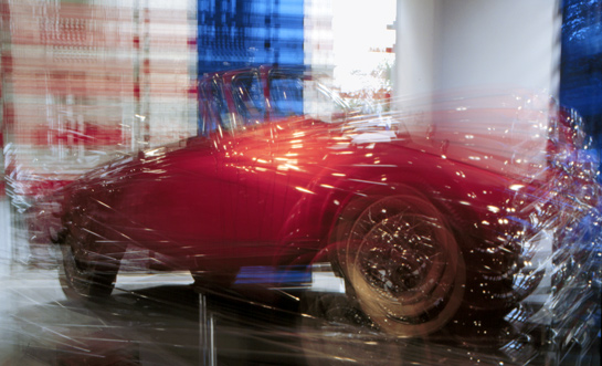red white blue tricolor Peugeot multiple exposure France car showroom