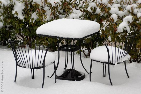cafe table chairs in snow