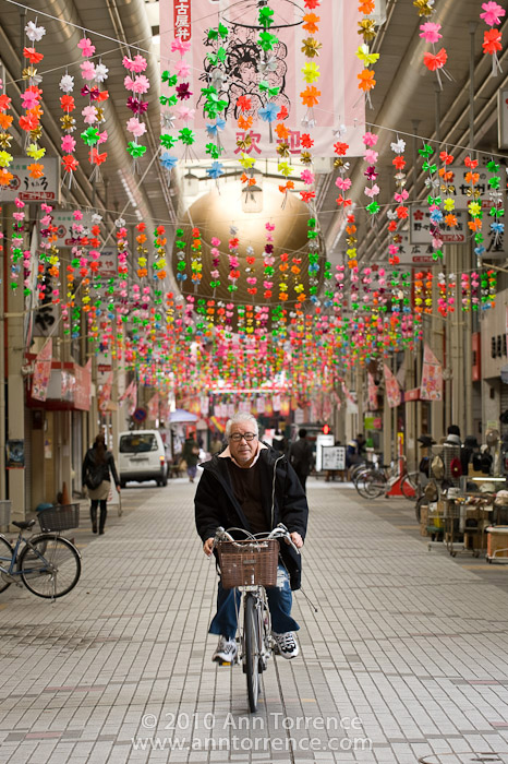 bicyclist in shopping arcade near Osu Kannon Temple, Nagoya, Japan