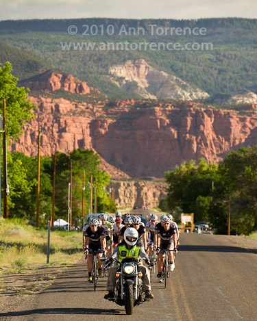 Volunteer motorcyclist leads Capitol Reef Classic participants at the start of a race in Teasdale, Utah