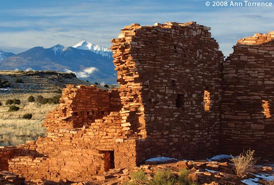wuaptki national monument anasazi ruin lomaki pueblo snow mountains