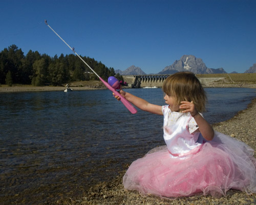 little girl fishing on the Snake River in fairy costume
