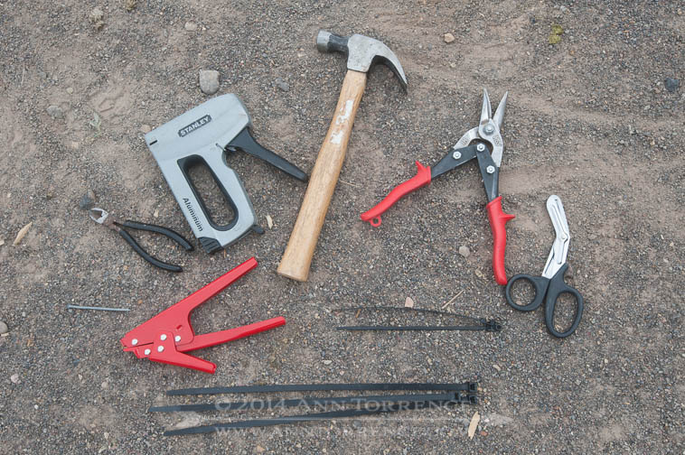 Tools: hammer, heavy snips, surgical shears, cable ties in two sizes, cable tie tightener, staple gun