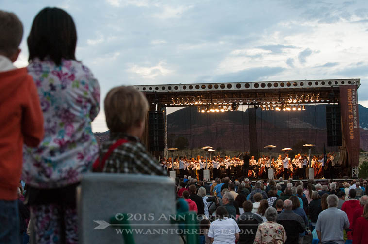 Children watch the Salt Lake Symphony open its Mighty 5 Tour on Tuesday August 12, 2014 at Teasdale Community Park in Teasdale, Utah.