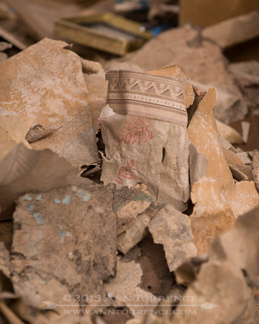 Wallpaper and other debris discarded from Torrey's oldest house.